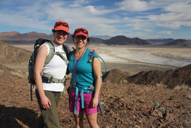 Dr. Phoebe Cohen ® demonstrates that not all field clothes have to be olive green or khaki, while doing fieldwork in Death Valley, California with Smithsonian/University of Maryland PhD student Sarah Tweedt.