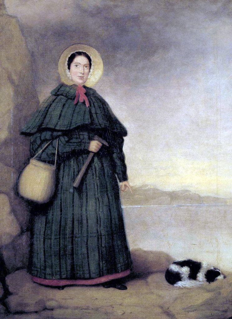 "The greatest fossil hunter ever known May 21, 1799 – March 9, 1847 Learned to read & write at Congregationalist Sunday school Field site: Lyme Regis (Dorset, England) Photograph credit: Portrait of Mary Anning with her dog Tray and the Golden Cap outcrop in the background, Natural History Museum, London. It is credited to ""Mr. Grey."" This image was downloaded from Wikimedia Commons."